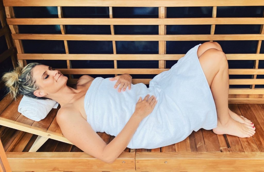 Lauren Roxburgh laying in infrared sauna
